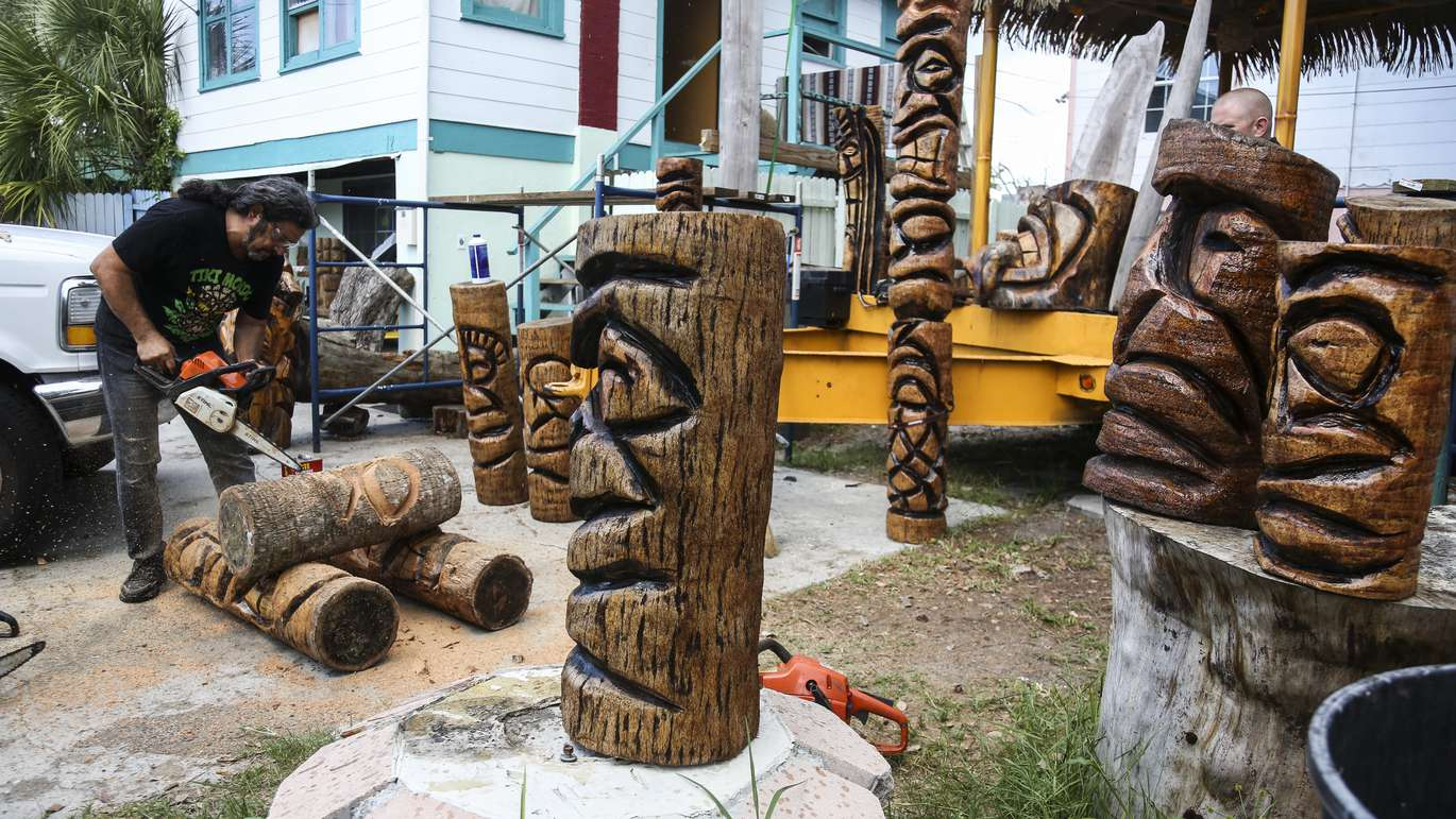 Wes Wing carves a new tiki head at his workshop in St. Petersburg, Florida on June 13, 2018. After being inspired by his first tiki head creation during Hurricane George in 1998, Wing has created over 6,000 tiki heads with his team. His company, Tiki Mondo, also installs tiki huts and tiki bars. EVE [EDELHEIT   Times]