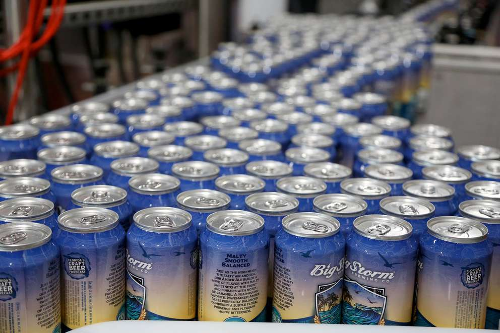 Some of the 4,920 cans of Wavemaker Amber Ale being filled with beer on Tuesday at Big Storm Brewing Companys brewing facility in Clearwater. Many beer brewers say the steel and aluminum import tariffs of 25 percent on steel and 10 percent for aluminum being pressed ahead by President Donald Trump will have a big impact on their costs to can beer as a small business, and could up the price of a four-pack by 50 cents. Plans for the tariffs, set to start late next week, have stirred opposition from business leaders and prominent members of the Republican Party, who fear the duties could spark retaliation from other countries and hurt the U.S. economy. (DOUGLAS R. CLIFFORD   Times)