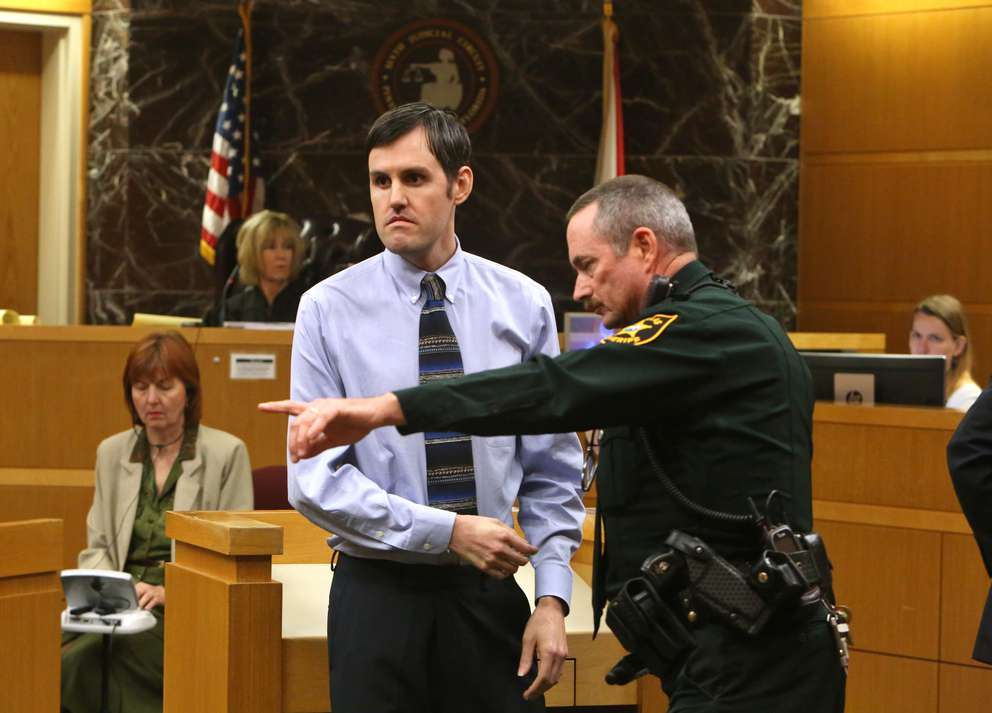 Defendant John Jonchuck turns as a bailiff points to the area of the courtroom where there is a fingerprint station. He was found guilty of first-degree murder moments before. [SCOTT KEELER | Times]