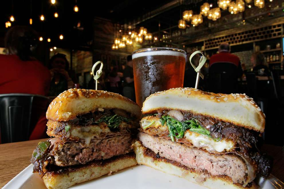 The Brie Burger at Craft Street Kitchen in Trinity features pistachio crusted brie, fig jam, prosciutto and arugula. Times (2015)