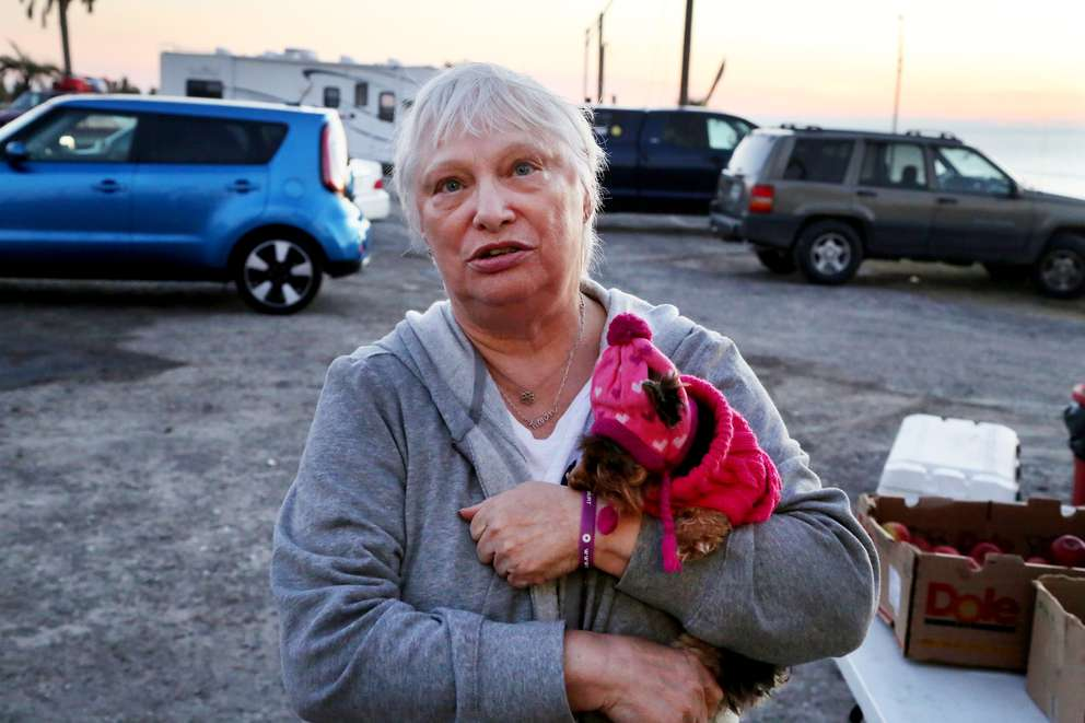 Karen Buddo, 68, of Mexico Beach, holds her teacup Yorkie while waiting for a hot meal two months after Hurricane Michael. DOUGLAS R. CLIFFORD | Times
