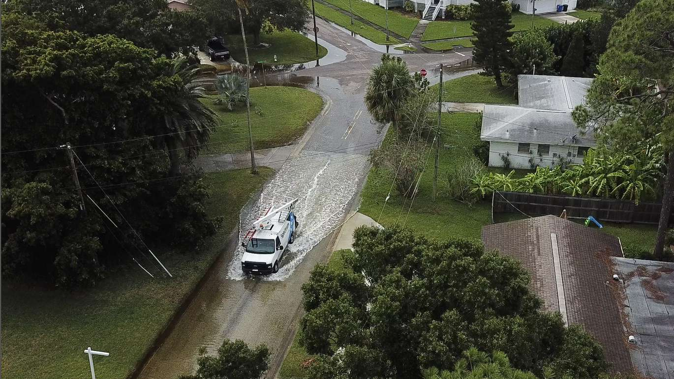 As high tide approaches, streets begin to flood due to Hurricane Michael in the Shore Acres neighborhood of St. Petersburg Wednesday afternoon. (Dirk Shadd, Times)