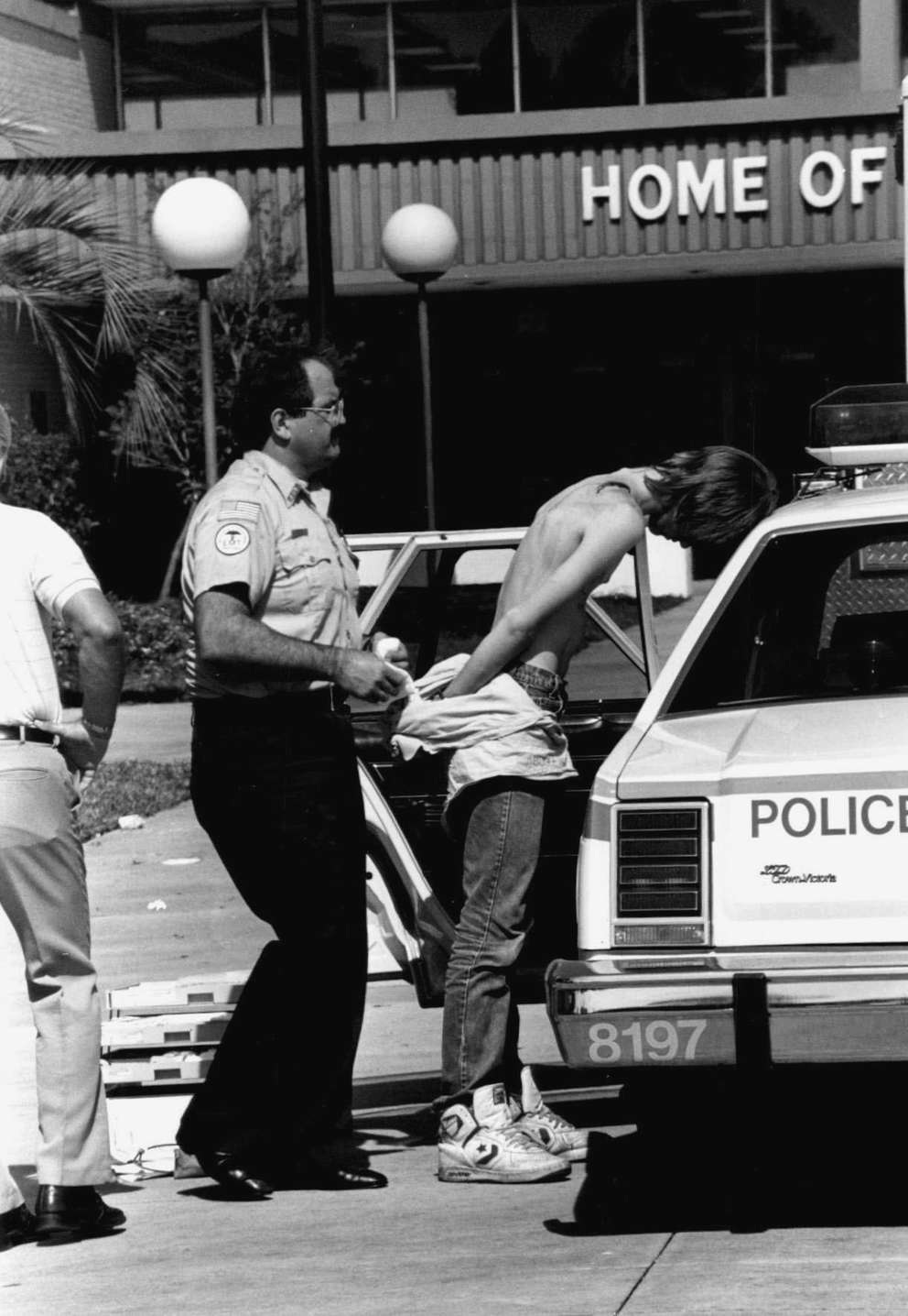 Jason Harless being was arrested after the shooting. [Times archives]