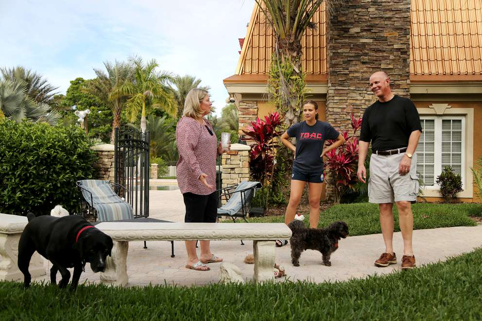 Pinellas-Pasco Circuit Judge Lauralee Westine, left, and her husband hang out with their daughter, Lauren, 13, while taking their dogs MacDuff and Graham outside. [DOUGLAS R. CLIFFORD | Times]