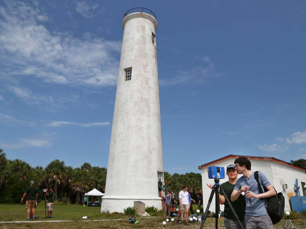 Kara Cook, graduate student, and Elliot Alvarez, research assistant, both from the University of South Florida, crank up a 3D scanner next to the Egmont Key lighthouse. They're part of a team producing detailed images of historic sites on the island before the sites are lost to erosion. [SCOTT KEELER | Times]