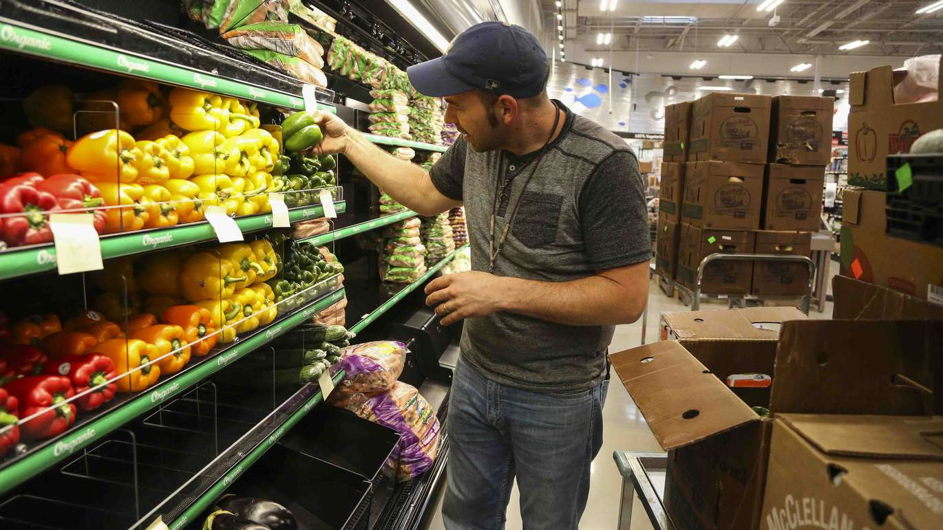 Paul Davison helps set up the new produce section at the new Earth Fare grocery store in Seminole on Monday, September 26, 2016. The new grocery store is set to open on Wednesday, September 28 in Seminole City Center. [EVE EDELHEIT | Times]