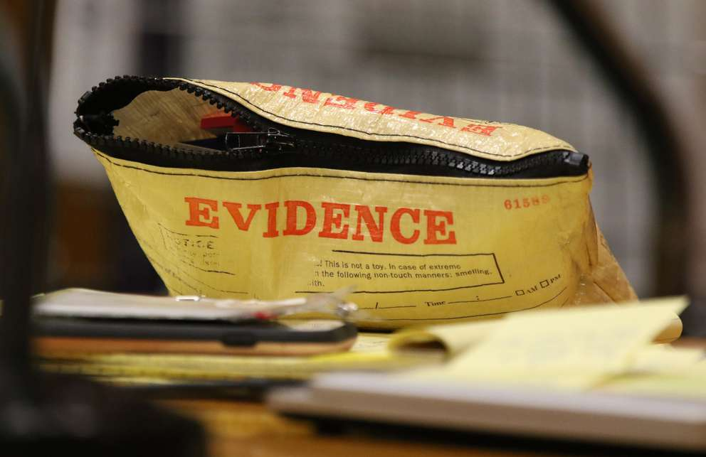 One of the defense lawyer's pencil bags is labeled