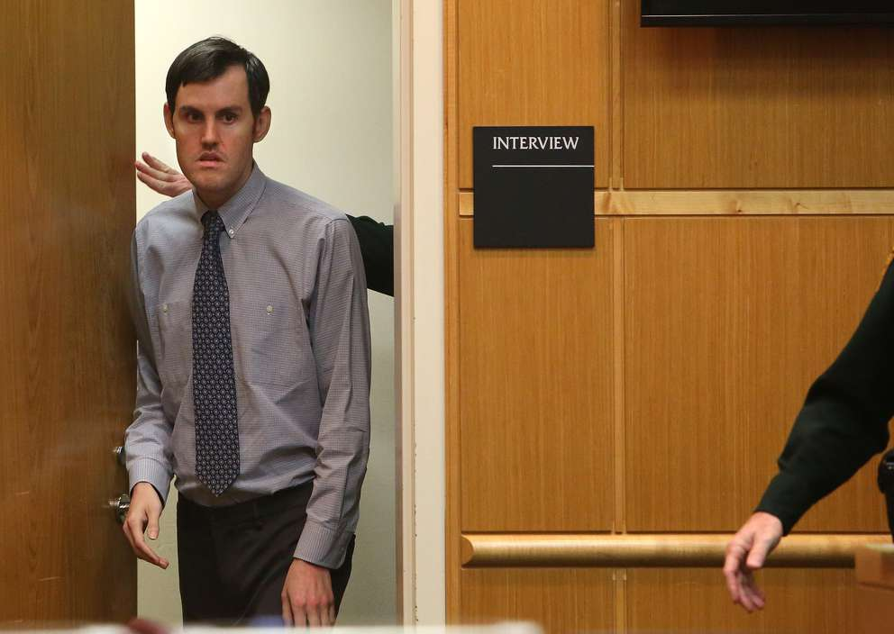 Defendant John Jonchuck is lead through the courtroom after meeting with court psychologist Jill Poorman. SCOTT KEELER | Times