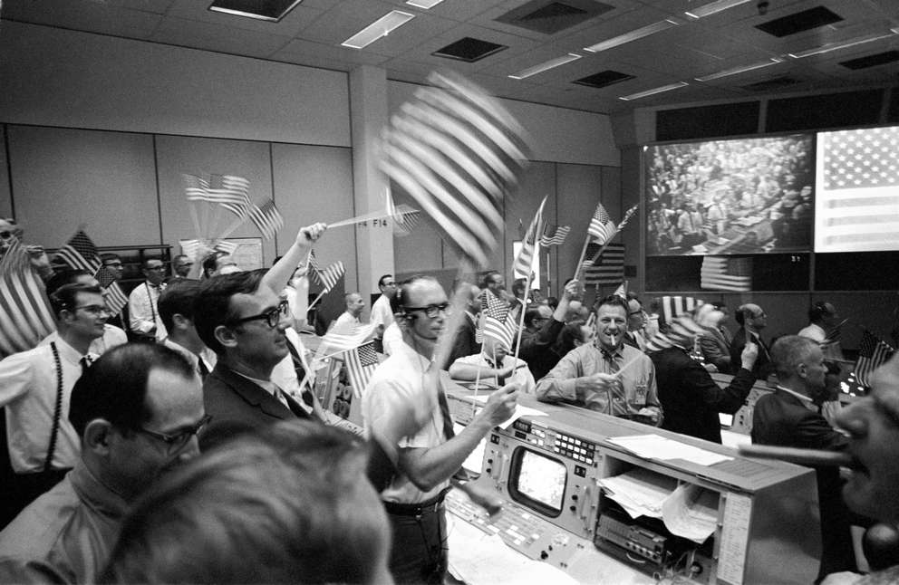 In this July 24, 1969 photo, flight controllers at the Mission Operations Control Room in the Mission Control Center at the Manned Spacecraft Center in Houston, celebrate the successful conclusion of the Apollo 11 lunar landing mission. AP Photo | NASA
