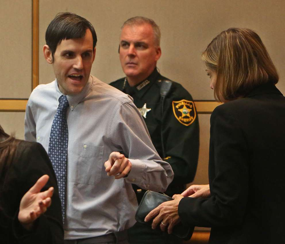 Defendant John Jonchuck, left, talks with his attorney Jane McNeill, right, during a break in his murder trial. SCOTT KEELER | Times
