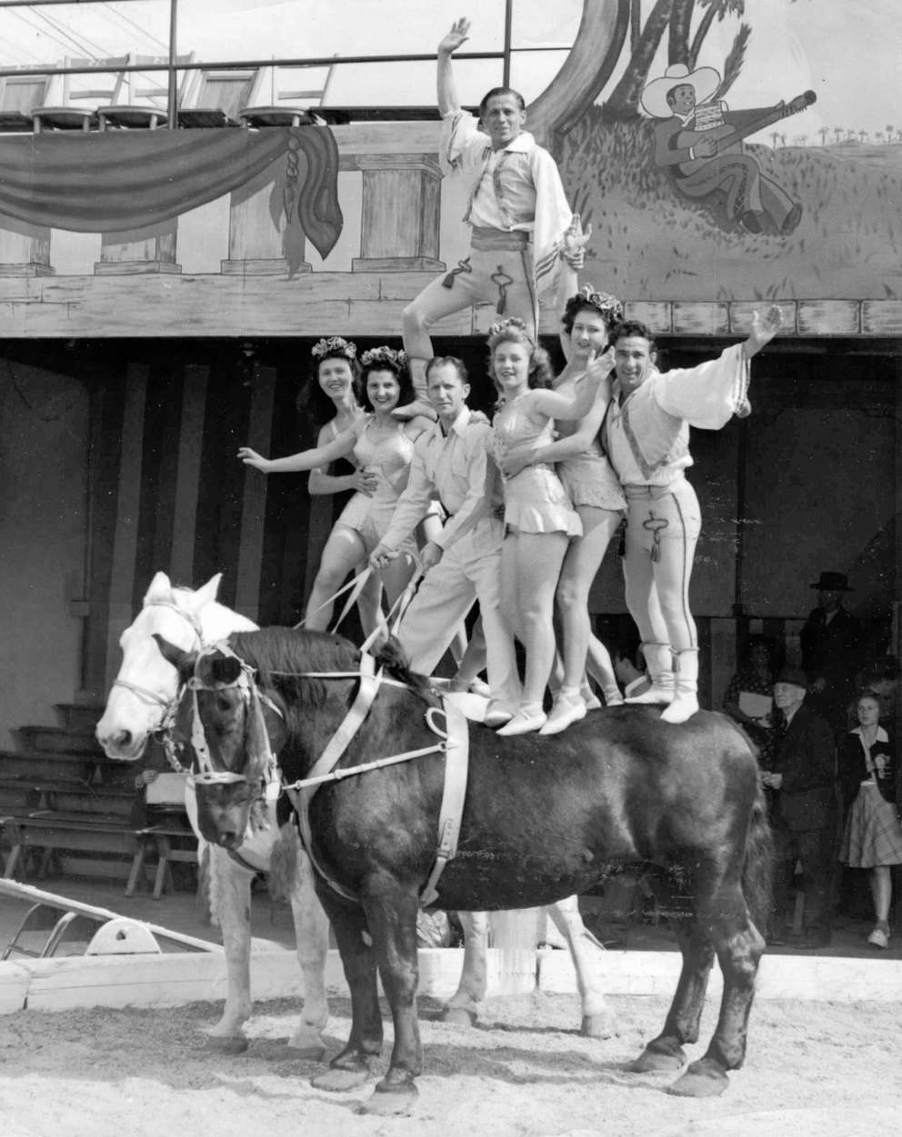 Doc Webb holds reins in horse balancing act during a circus at Webb's City. [Times files]