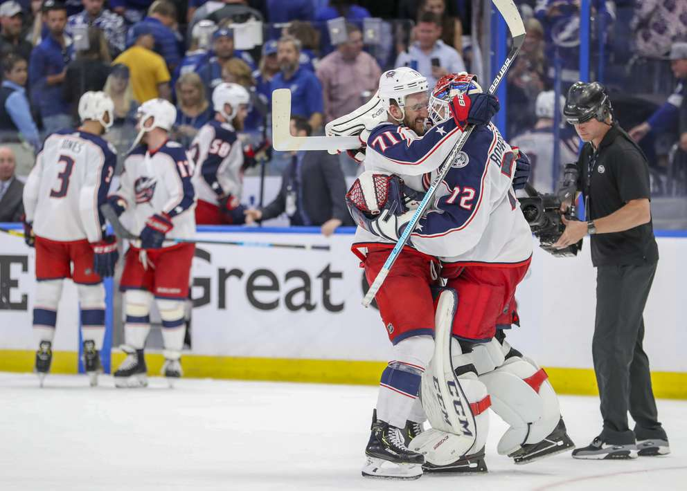 DIRK SHADD   Times Columbus Blue Jackets left wing Nick Foligno (71), left, celebrates with Columbus Blue Jackets goaltender Sergei Bobrovsky (72) celebrate their 4-3 win over Tampa Bay Lightning in the first round of the NHL Stanley Cup Playoffs Wednesday, April 10, 2019 in Tampa.