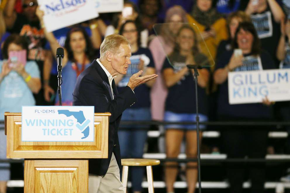 OCTAVIO JONES | TimesU.S. Sen. Bill Nelson, right, blows a kiss before giving a speech during the Florida Democratic Party rally held at the University of South Florida in Tampa, Florida on Monday, October 22, 2018.