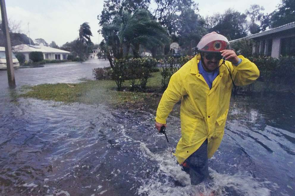 TFD driver/engineer David Bibiloni braves deep water and heavy winds to tell residents of the Sunset Park area of Tampa of a mandatory evacuation due to rising water. [Times files (1993)]