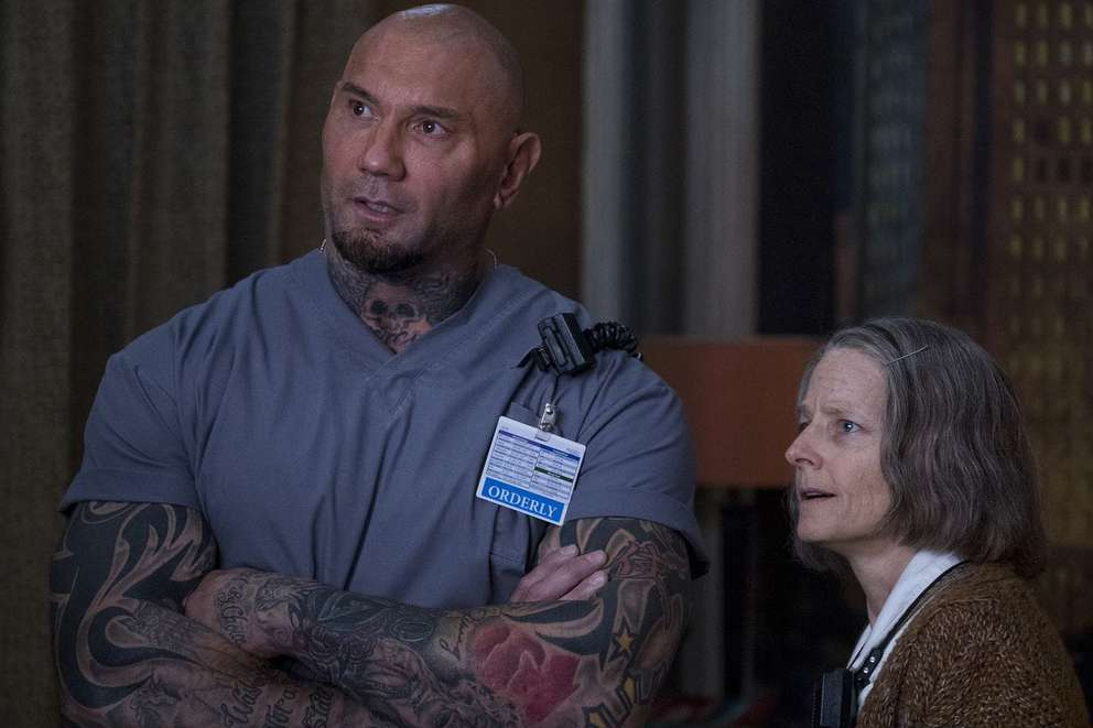 Dave Bautista, left, with Jodie Foster in