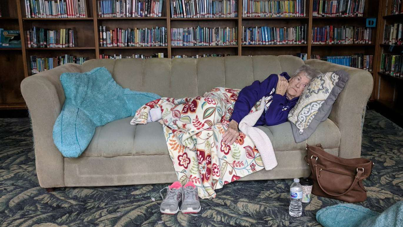 Wynell Burke, 84, of Port St. Joe, rests at the shelter in the library at the Port St. Joe High School on Wednesday. Burke, who has lived in the city since she was 8 years old, said she is worried about her home because it is surrounded by pine trees. (Douglas R. Clifford | Times)