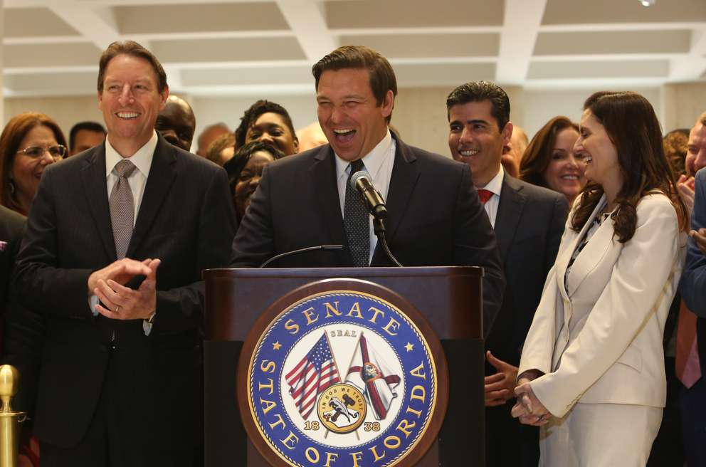 Left to Right: Senate President Bill Galvano, R- Bradenton, Florida Governor Ron DeSantis, House Speaker Jose Oliva, and Lt. Governor Jeanette Nunez all share a laugh during Sine Die at the Capitol on Saturday. [SCOTT KEELER | Times]