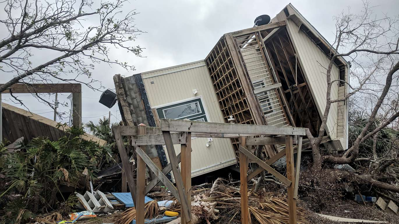 A home is tossed onto its side, with its foundation, at Mexico Beach nearly two months after Hurricane Michael made landfall. (DOUGLAS R. CLIFFORD | Times)