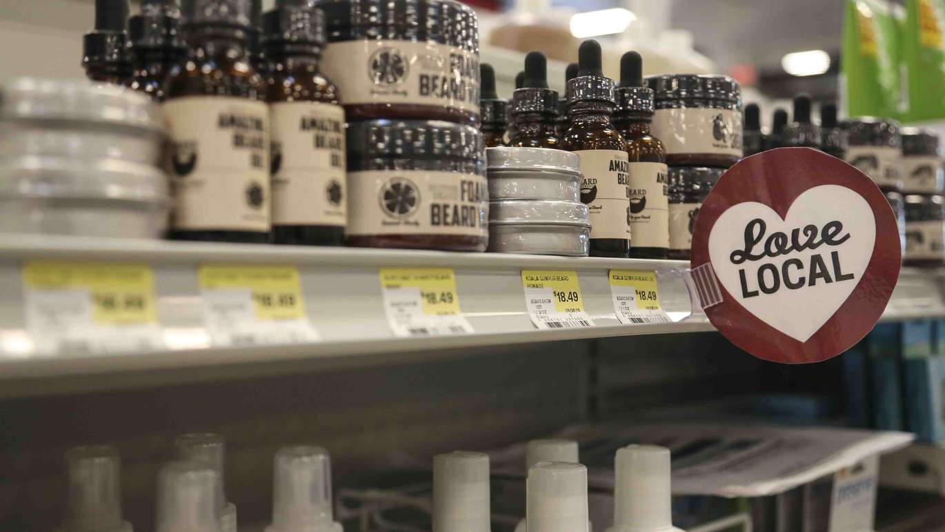 Local signs indicate local items available for sale throughout the new Earth Fare grocery store in Seminole on Monday, September 26, 2016. The new grocery store is set to open on Wednesday, September 28 in Seminole City Center. [EVE EDELHEIT | Times]