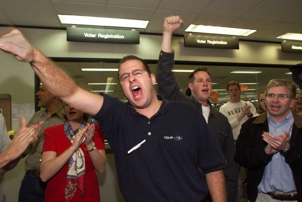 Republican Party observer Tom Pyle, from California, center, demonstrates outside the Miami-Dade County's elections office Wednesday, Nov. 22, 2000, at the Stephen P. Clark Goverment Center in Miami. Observers demanded to be allowed to be present at the counting of the 10,700 ballots. (AP Photo/Miami Herald, Carl Juste)