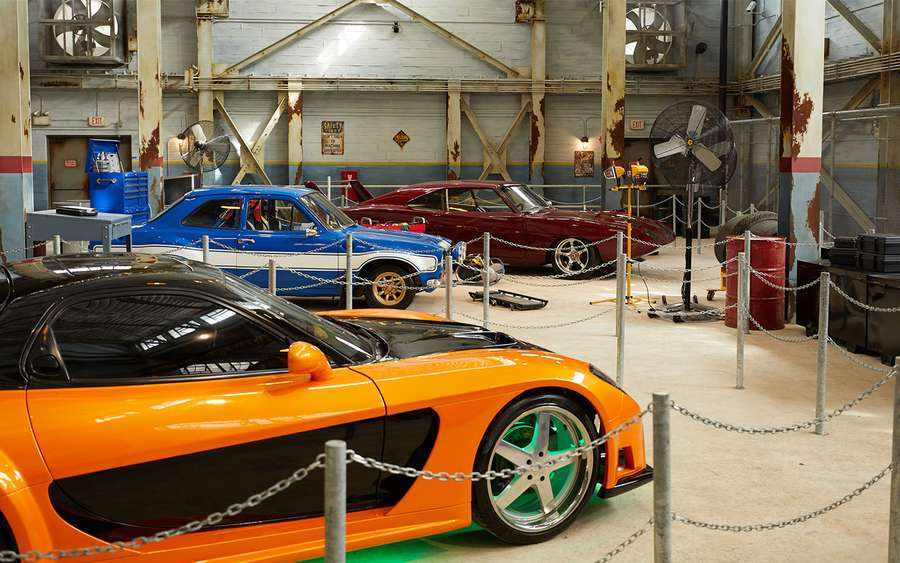 The new attraction Fast & Furious – Supercharged is open at Universal Orlando Resort. Inside, garages are filled with souped-up cars, including several from the Fast & Furious movies. [Universal Orlando Resort]