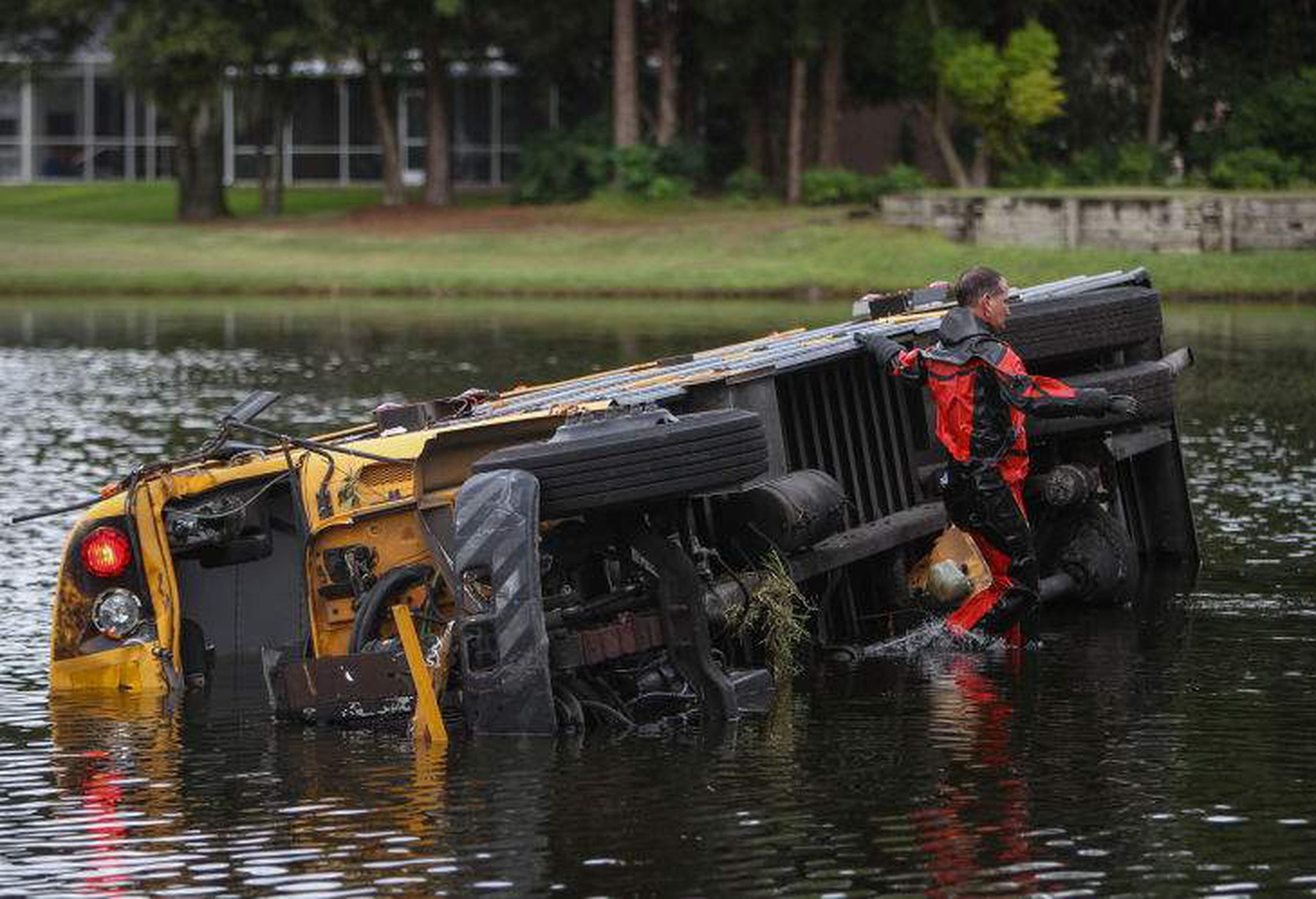 School bus carrying 27 kids plunges into water, 10-year-old