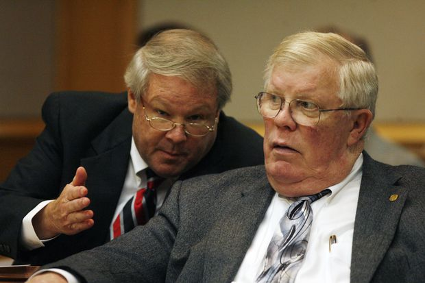 Chief Assistant State Attorney Bruce Bartlett, left, and Pinellas-Pasco State Attorney Bernie McCabe, right, confer during the Sept. 23, 2013 re-sentencing hearing of Nicholas Lindsey Jr. He was 16 when he killed St. Petersburg police Officer David Crawford in 2011. Lindsey was again sentenced to life in prison.
