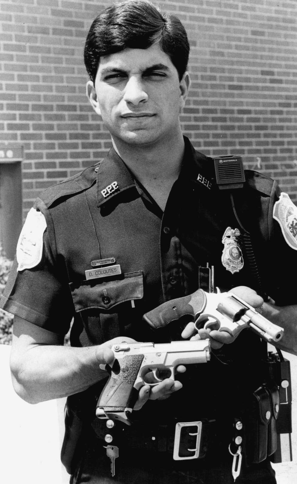 An officer holds a revolver and a semi-automatic handgun at Pinellas Park High. [Weaver Tripp | Times archives]