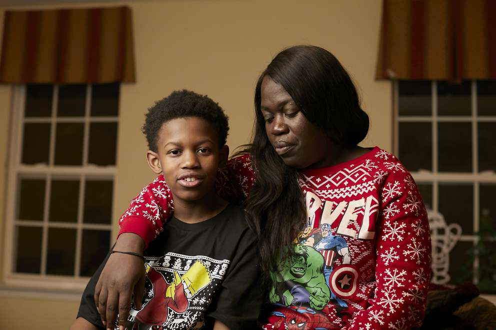 Ajani Dartiguenave, 12, with his mother, Claudia Charles, in Charlotte, N.C., where the boy recently experienced a school lockdown. [Photo for The Washington Post by Logan Cyrus]
