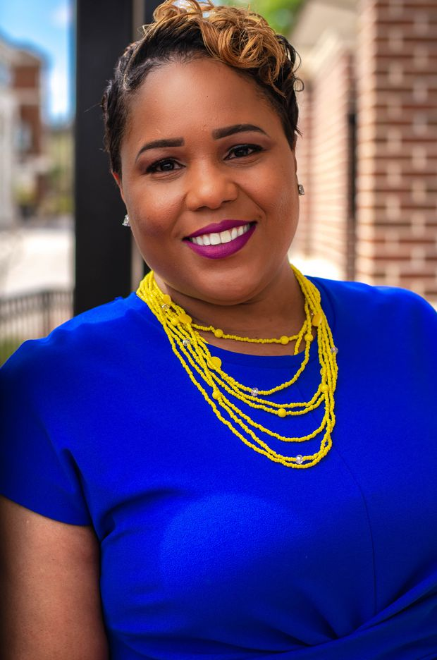 """Shown in a campaign photo, former Hillsborough County School Board member Tamara Shamburger is suing to try and regain her seat. She alleges the winner, Henry """"Shake"""" Washington, did not properly establish residence in the district."""