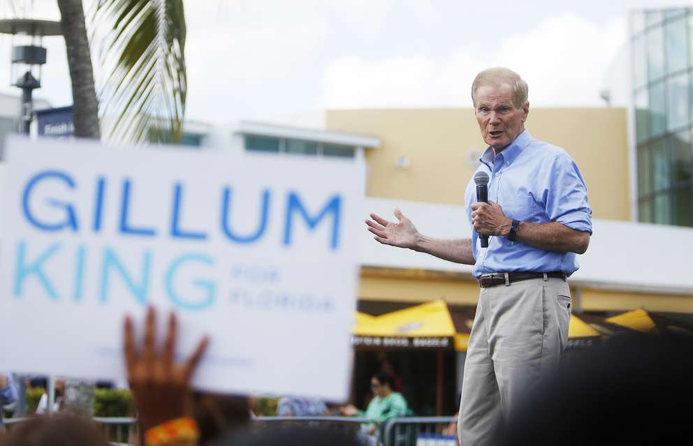 OCTAVIO JONES | Times Sen. Bill Nelson, D-Florida gives a campaign speech ahead of introducing Florida Gubernatorial Democratic candidate Andrew Gillum during a stop at Florida International University in Miami, Florida, on Thursday, October 25, 2018.