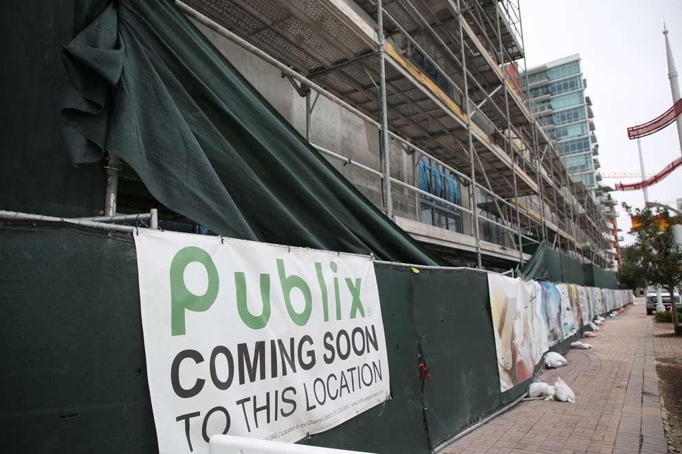 The construction site of Channel Club - an apartment tower with a Publix supermarket - in the Channel District. [Times (2018)]