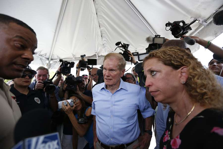 U.S. Sen. Bill Nelson, center and congresswoman Debbie Wasserman Schultz, right, were denied entry by security into the Homestead Temporary Shelter for Unaccompanied Children on June 19 in Homestead. (AP Photo/Brynn Anderson)