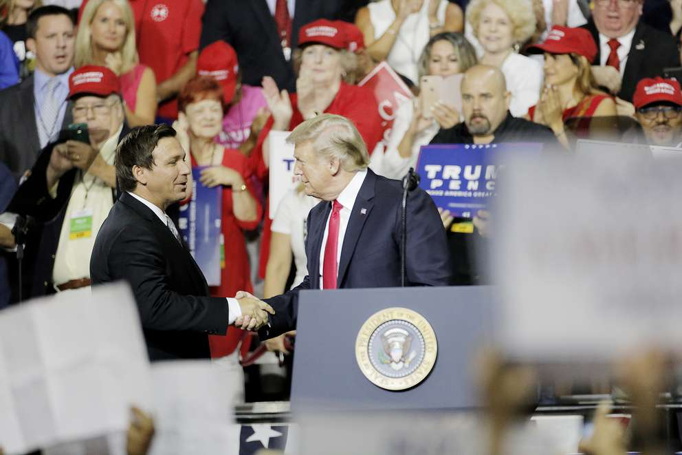President Donald Trump, right, welcomes Florida gubernatorial candidate Rep. Ron DeSantis, R-Palm Coast, on stage during a rally at the Florida State Fairgrounds in Tampa on Tuesday. (OCTAVIO JONES | Times)