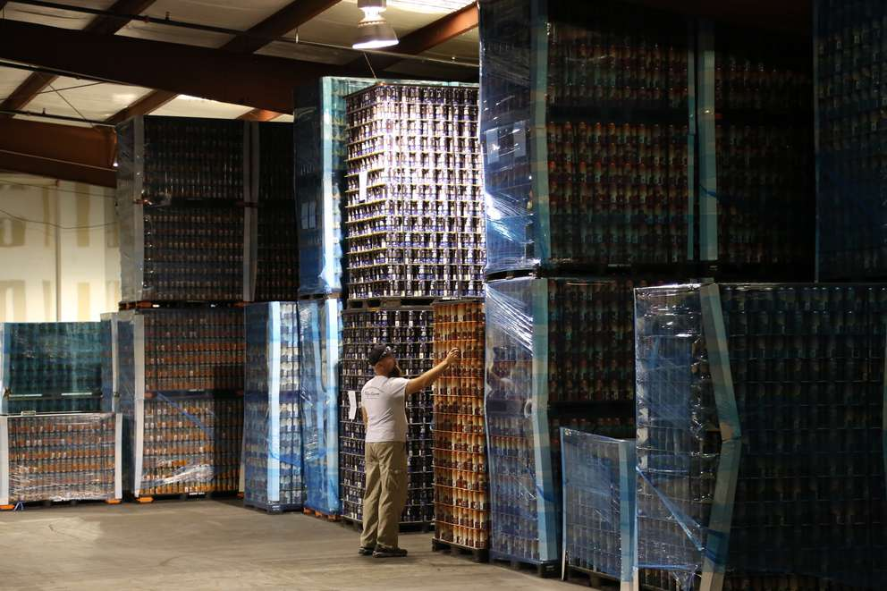 Lead truck driver Brian Tilki, of Largo, inspects stacks of pallets containing empty aluminum cans on Tuesday at Big Storm Brewing Companys brewing facility in Clearwater. Many beer brewers say the steel and aluminum import tariffs of 25 percent on steel and 10 percent for aluminum being pressed ahead by President Donald Trump will have a big impact on their costs to can beer as a small business, and could up the price of a four-pack by 50 cents. Plans for the tariffs, set to start late next week, have stirred opposition from business leaders and prominent members of the Republican Party, who fear the duties could spark retaliation from other countries and hurt the U.S. economy. (DOUGLAS R. CLIFFORD   Times)