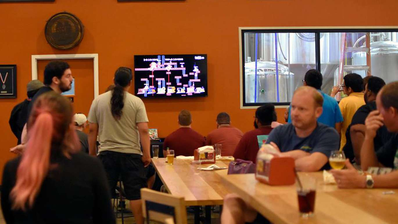 Pints & Pixels gaming night takes place at Brew Bus Brewing in Tampa. Event organizer NerdBrew brings out classic game consoles that are free to play. [Courtesy of NerdBrew]