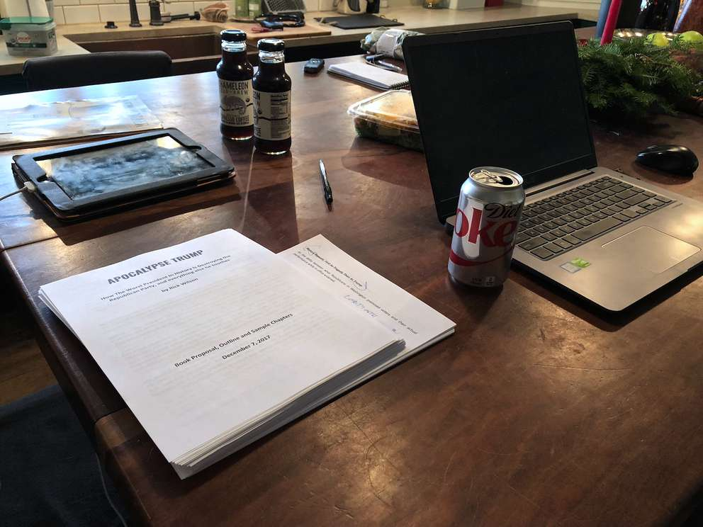 A draft of Wilson's new book, Apocalypse Trump, on his kitchen table in Tallahassee, where he often works, fueled by outrage and Diet Coke. (Alex Leary | Times)