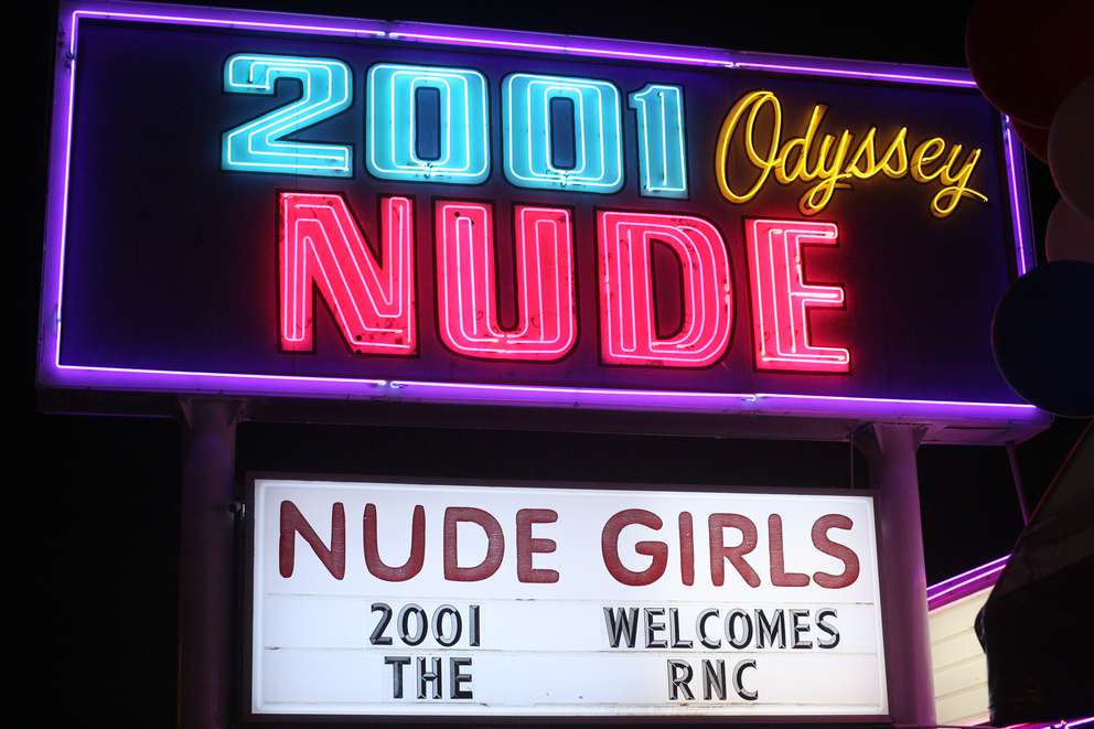 The sign outside of 2001 Odyssey strip club welcomes the RNC in Tampa. The club went through renovations in anticipation of increased business due to the convention. It also added a temporary private tent entrance to ensure the privacy of patrons who want to attend anonymously. Times (2012)