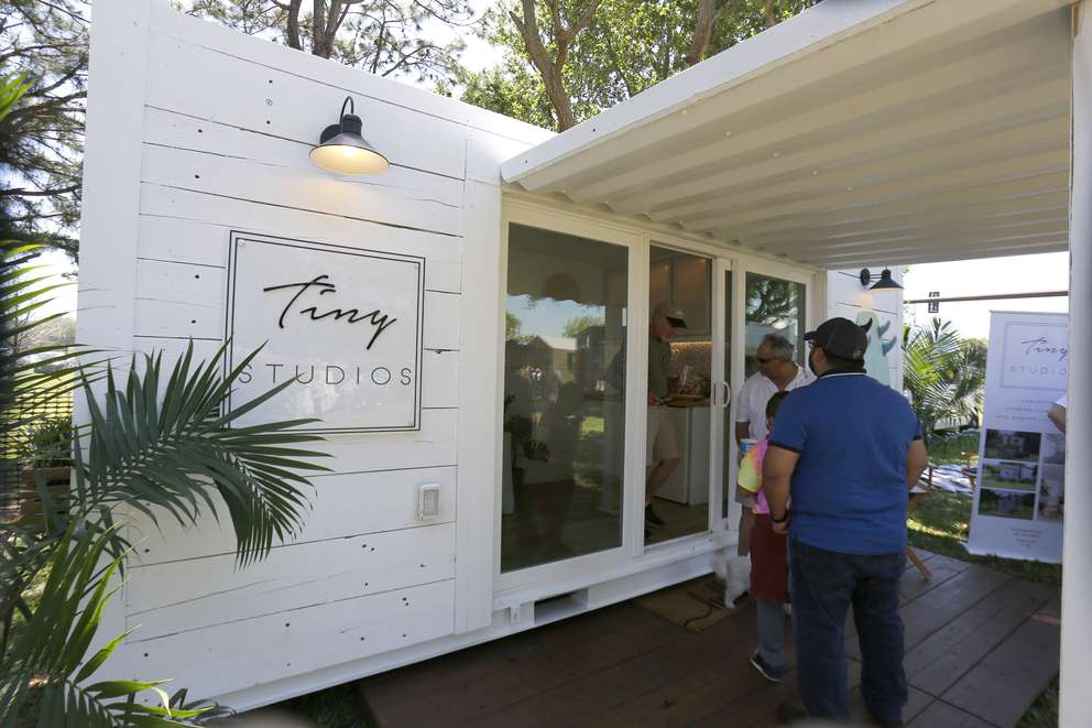 LUIS SANTANA | Times The Tiny Studios Bungalow which is a converted 20' shipping container featuring 160sq ft of living space starts at $42,350 at the St. Pete Tiny Home Festival featuring the latest and greatest of tiny home living at St. Petersburg College on Saturday, March 23, 2019 in St. Petersburg.