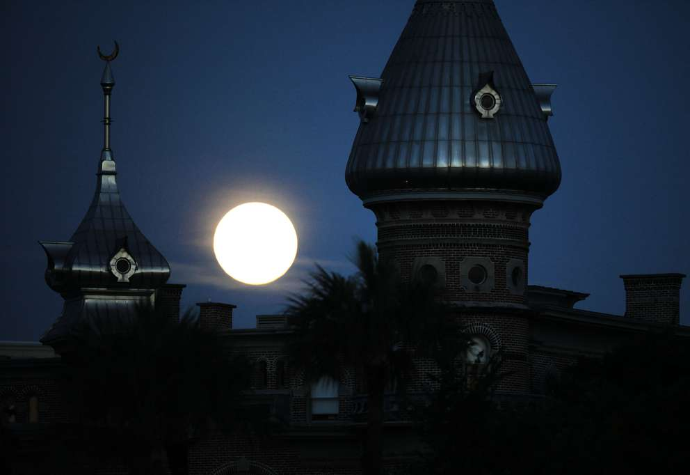 The minarets of the Henry B. Plant Museum with a supermoon in the background. Times (2013)