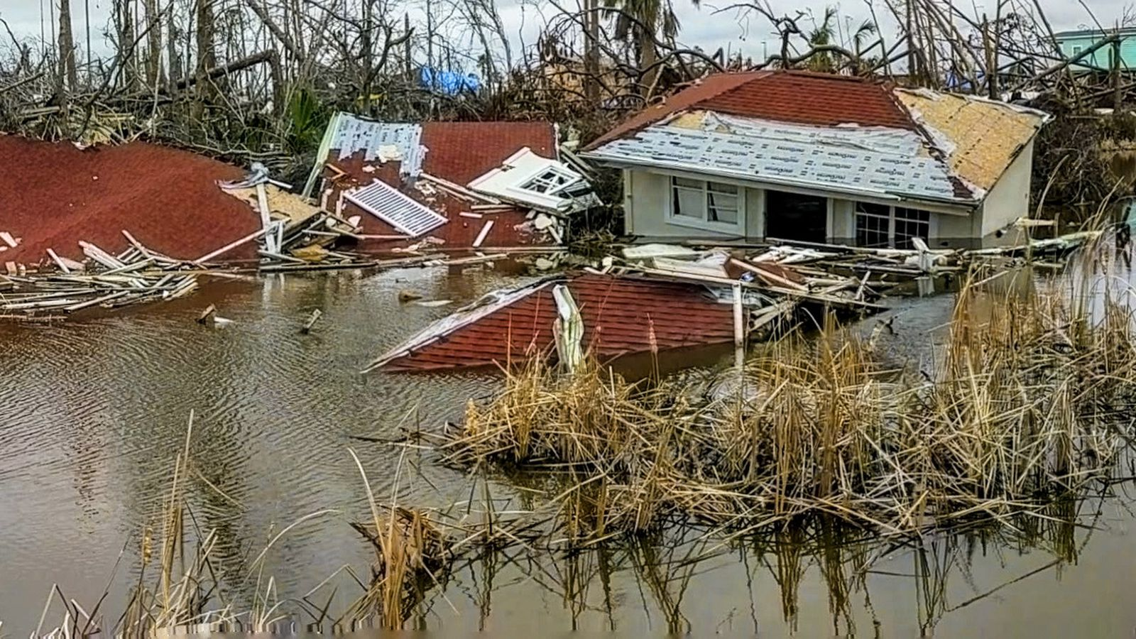 Part of a house still lay submerged in a canal in Mexico Beach two months after Hurricane Michael. DOUGLAS R. CLIFFORD | Times (2018)