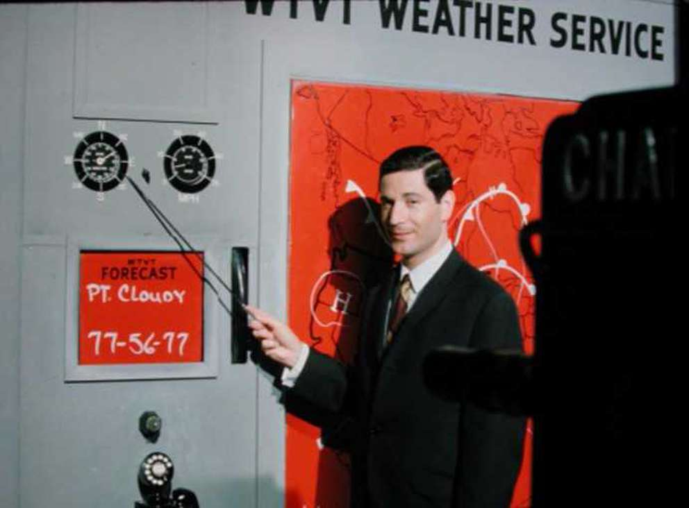 Roy Leep presents a forecast on WTVT in 1960. He is pointing to a working wind gauge, one of the most advanced meteorological instruments ever seen in a televised local forecast in an era when most weather reports were given using only chalkboards, magnets, and drawings. [Courtesy of Roy Leep | Times archives]