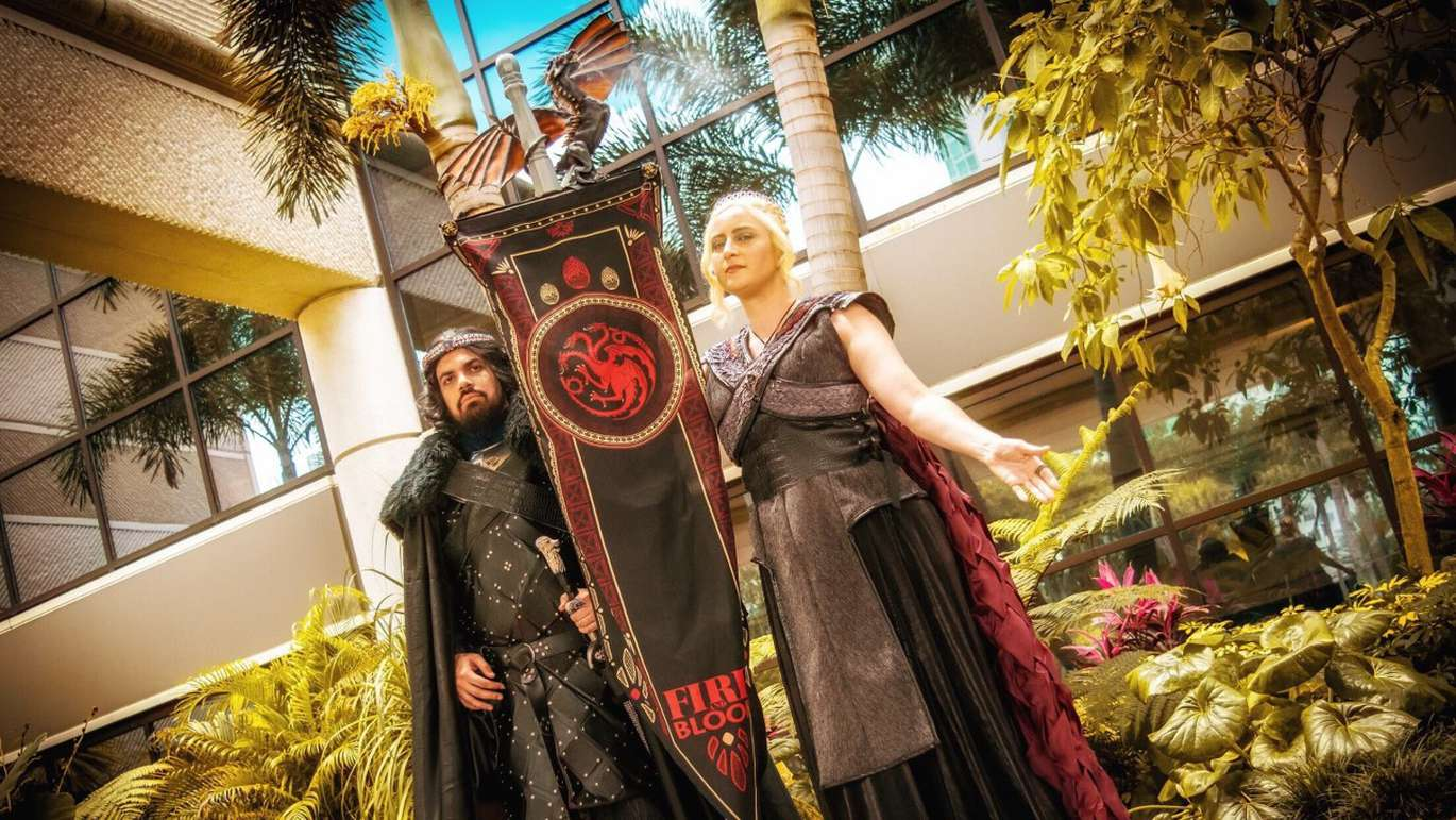 Tampa piano teacher Anne Rosato, 36, and her partner Anthony Acosta, 28, an IT specialist for USF, wearing Game of Thrones-themed Jon Snow and Daenerys Targaryen costumes. The dragon on top of the banner breathes fireball-scented smoke. [Courtesy of Anne Rosato]