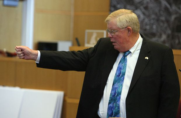 Pinellas-Pasco State Attorney Bernie McCabe holds out his hand to simulate firing a gun during closing arguments in the 2012 murder trial of Nicholas Lindsey Jr., who was convicted of killing St. Petersburg police Officer David Crawford in 2011.