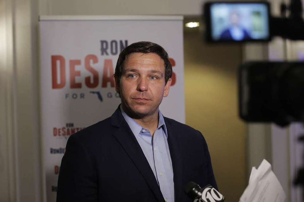 Florida gubernatorial candidate Ron DeSantis talks with reporters after giving a campaign speech at the Tampa Waterside Marriott on Monday. Fox News conservative talk show host Sean Hannity campaigned for 2018 gubernatorial candidate Ron DeSantis during a stop in Tampa. [OCTAVIO JONES | Tampa Bay Times]