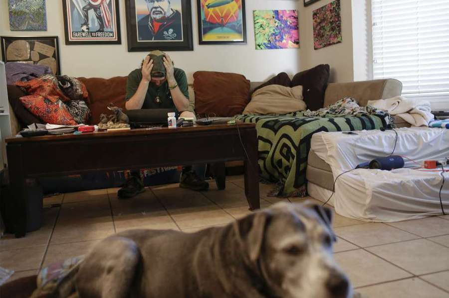 Adam Burchenal, with his dog, Sheldon, doesn't know what he'll do next. But he's heartbroken over the failure of Cee Bee's Citrus Emporium. [GABRIELLA ANGOTTI-JONES | Times]