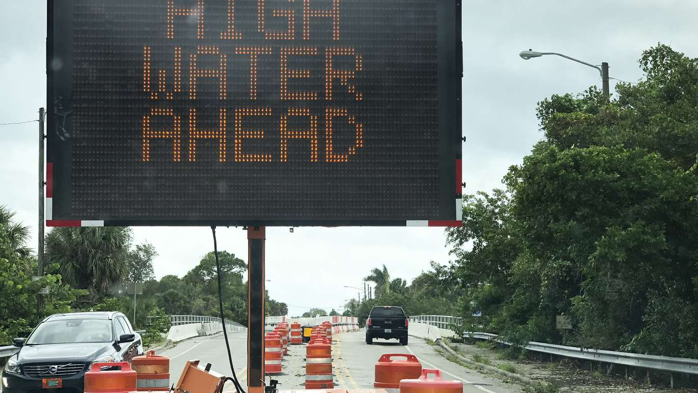The warning sign heading over the bridge onto Shore Acres inSt. Petersburg before high tide as Hurricane Michael passing offshore as it head to the Florida panhandle on Wednesday. (Dirk Shadd, Times)