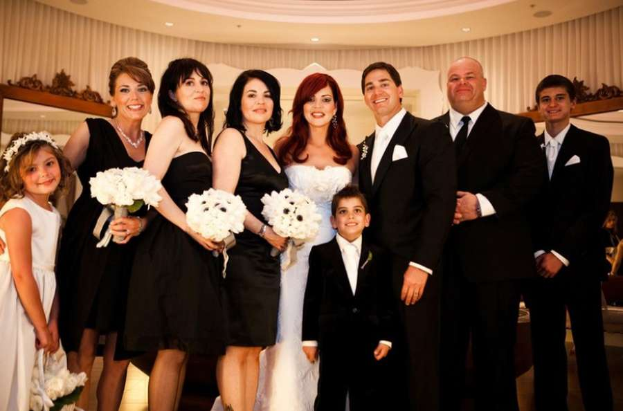 Nikki DeBartolo and Chad Chronister, center, were married in 2010 at the Ritz-Carlton Palm Beach in front of more than 200 guests. Boyz II Men, friends of the family, played at the reception. Also pictured are DeBartolo's son Asher, at center foreground, and Chronister's son Zack, far right. [Courtesy of Nikki DeBartolo]