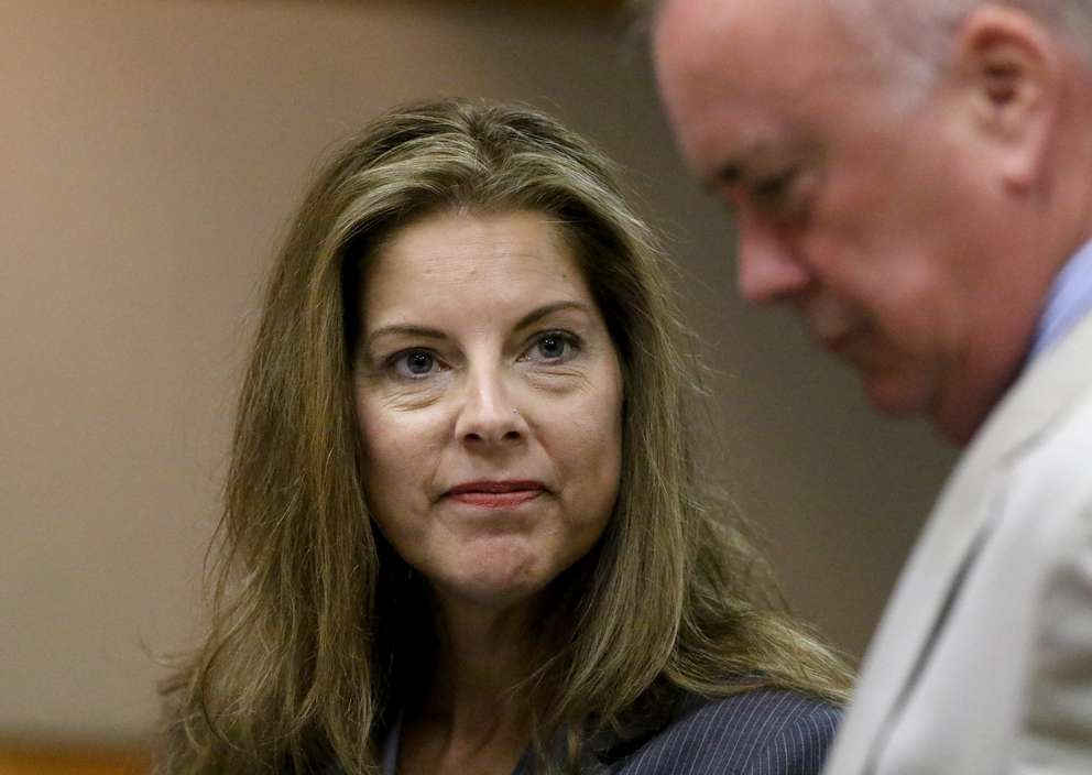 Defense attorneys Jane McNeill, center, and Greg Williams. [DOUGLAS R. CLIFFORD | Times]