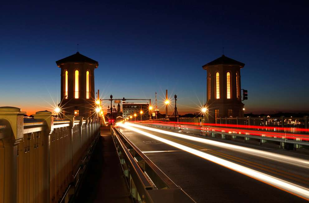 A slow shutter speed is used to captures vehicles crossing the Bridge of Lions, part of the A1A Scenic and Historic Coastal Byway, at dusk in St. Augustine. Courtesy of Visit Florida